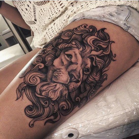 Löwen-Tattoo-am-Oberschenkel