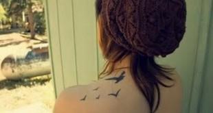 Schwalben Tattoo an der Schlter